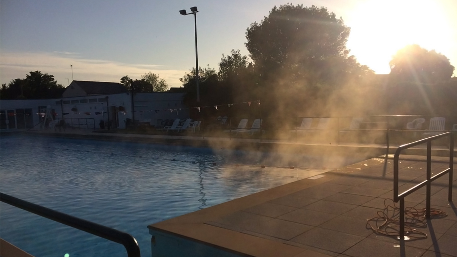 outdoor pool steaming in the morning sun