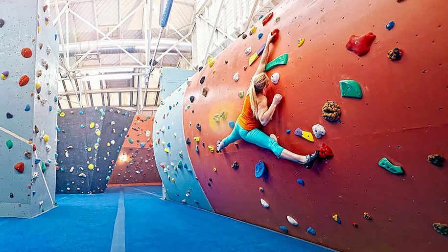 woman on rock climbing wall