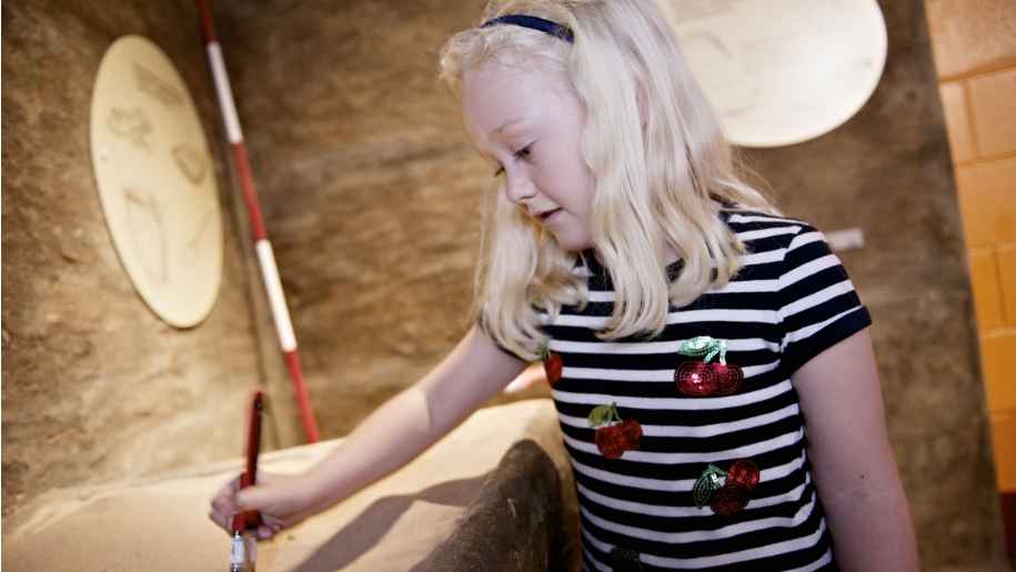 girl brushing artefact