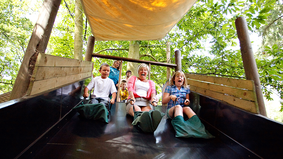 children laughing on slide