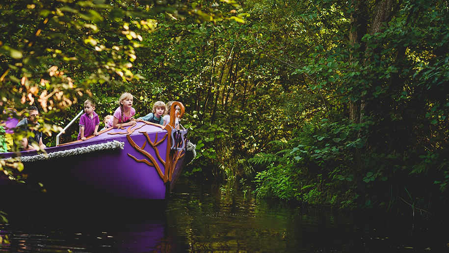 children on boat in Bewilderwood