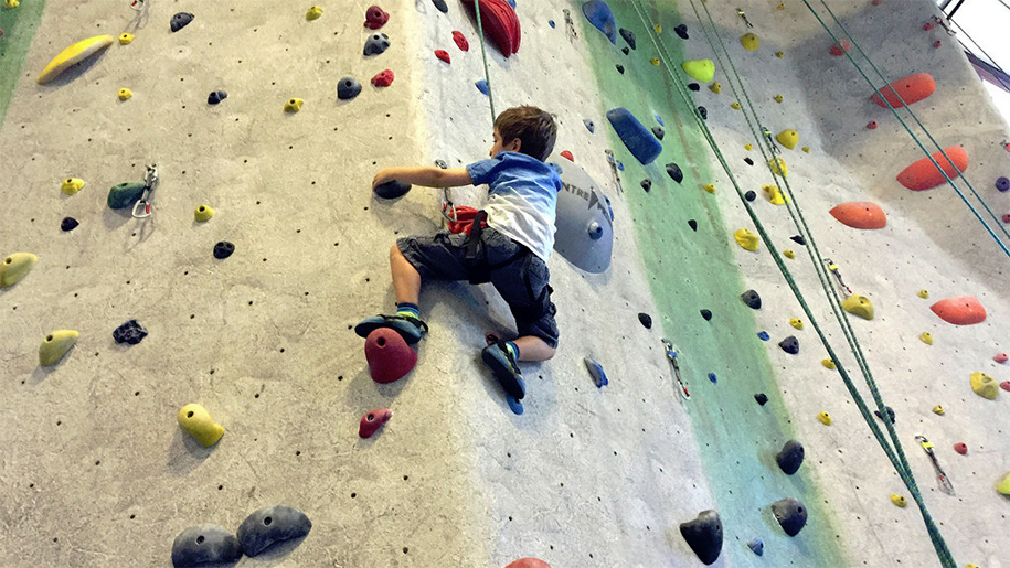 boy in rock wall