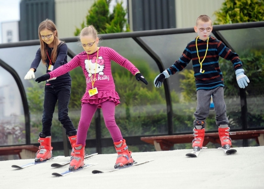 children on dry ski slope