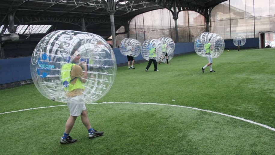 group playing bubble soccer