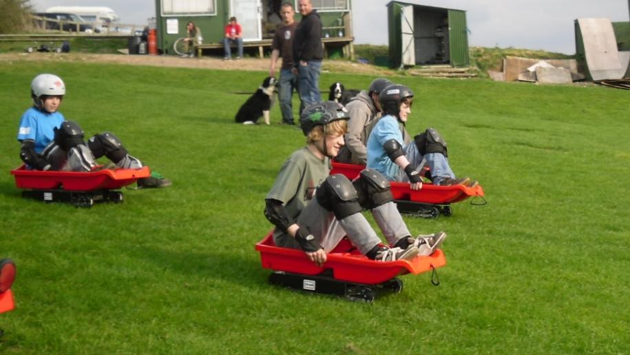 boys grass sledging