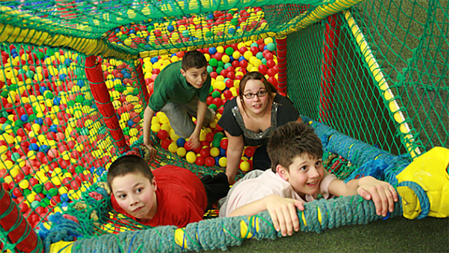 family in soft play area