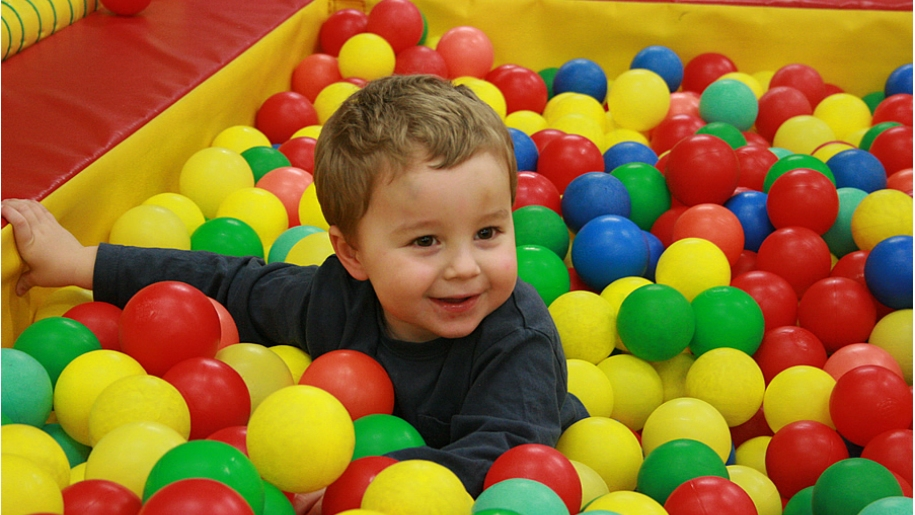 child in ball pool