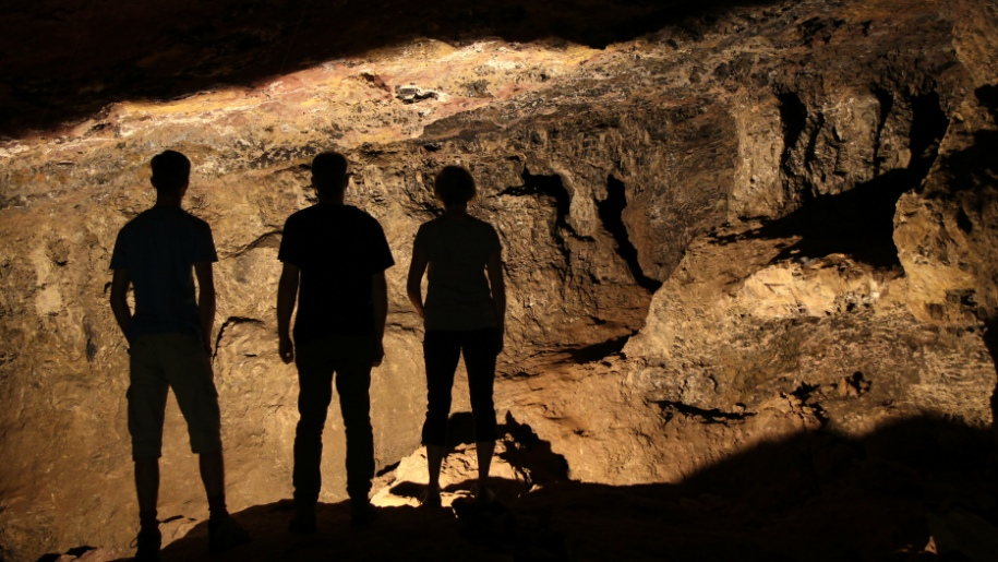 people standing in caves