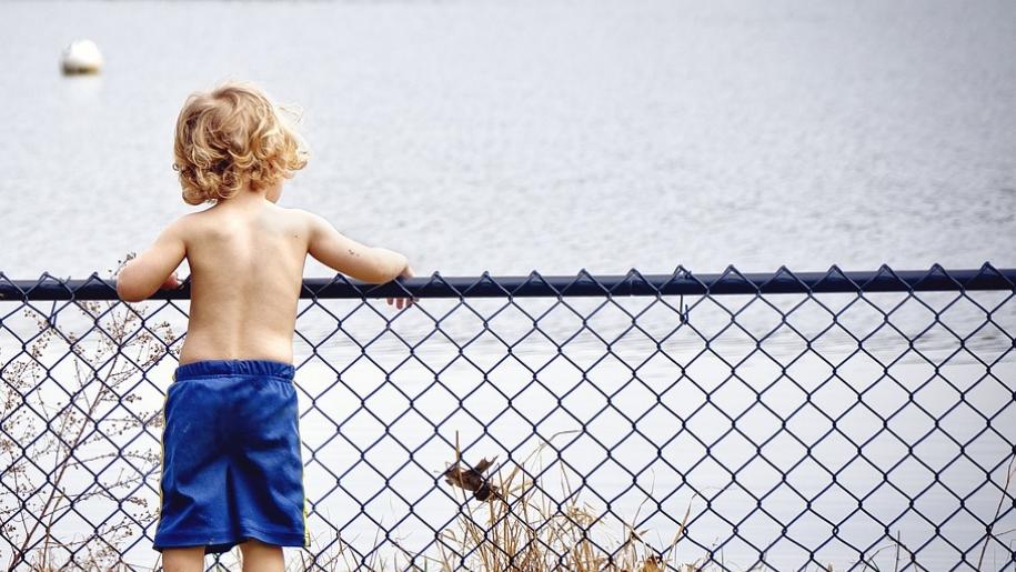 boy looking at lake
