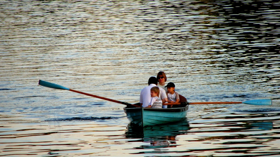family in rowing boat