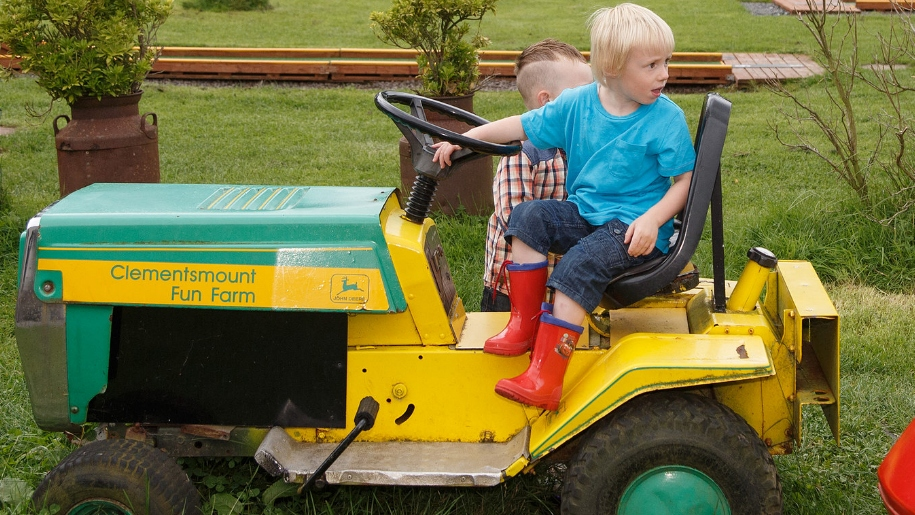 boys playing on tractor