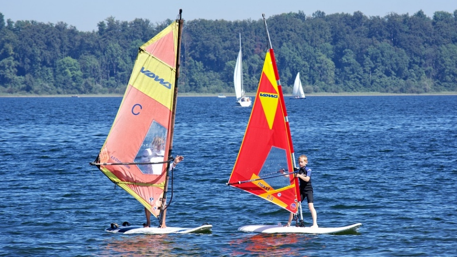 boy learning to windsurf