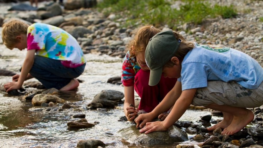 kids playing in stream