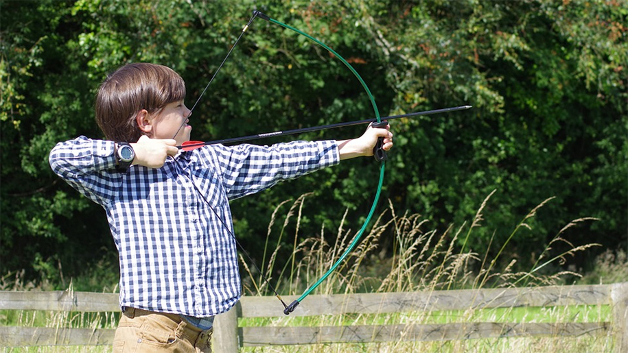 little boy practising archery