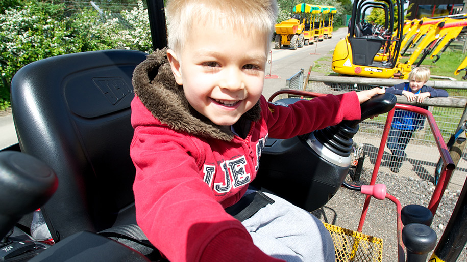 Diggerland child driving tractor