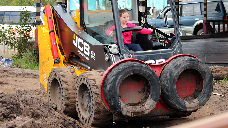 Diggerland girl driving tractor