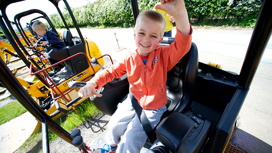 Diggerland child in tractor