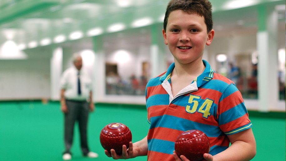 boy playing bowls