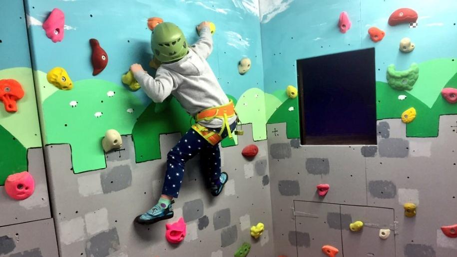 child on climbing wall