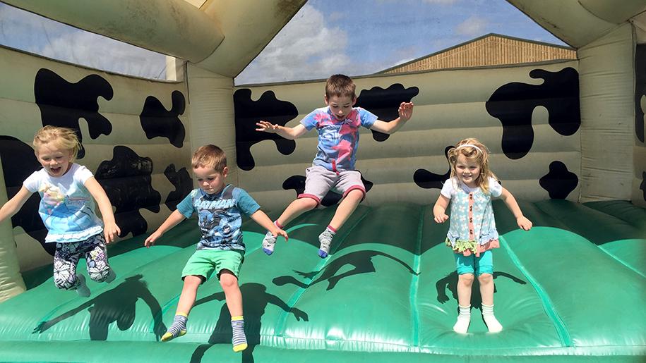 Farmer Palmers kids on bouncy castle