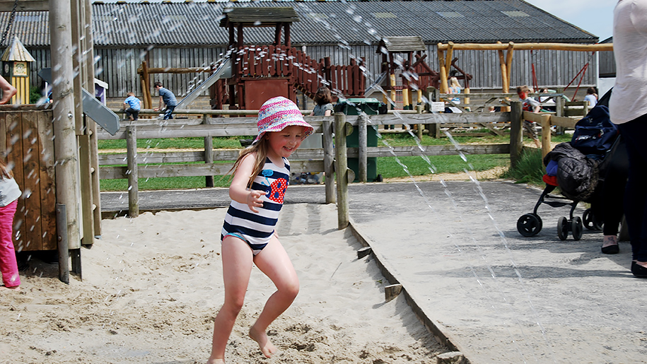 Farmer Palmers Child playing in sand