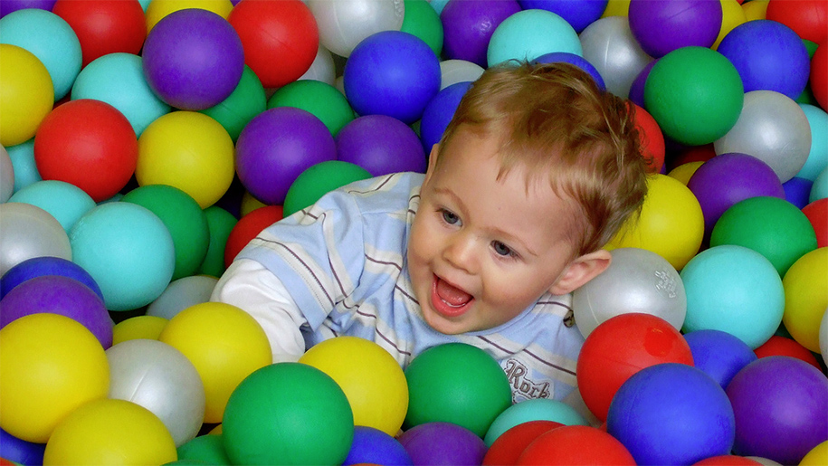 baby boy in ball pool