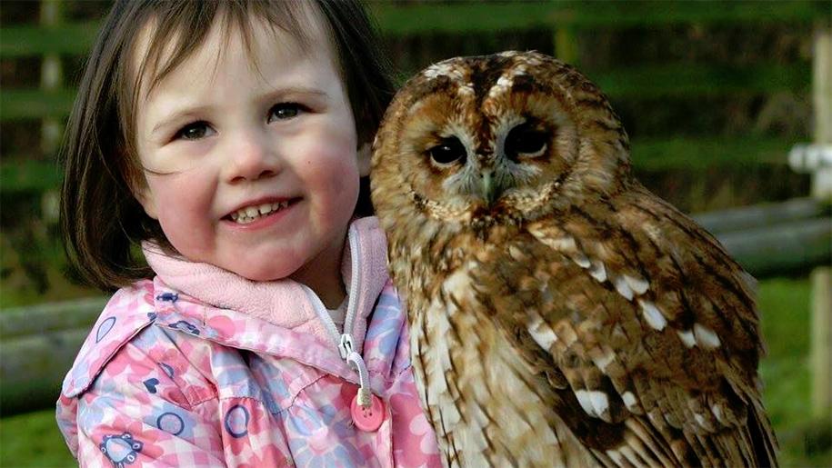 girl holding owl