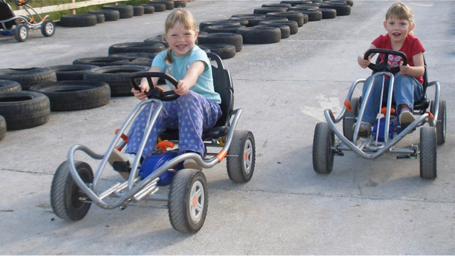 girls on pedal karts