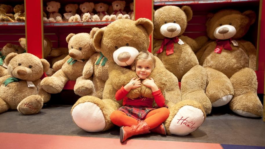 girl with Hamleys bear