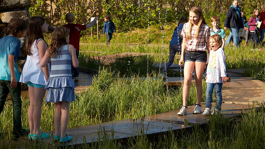 girls walking along walkway