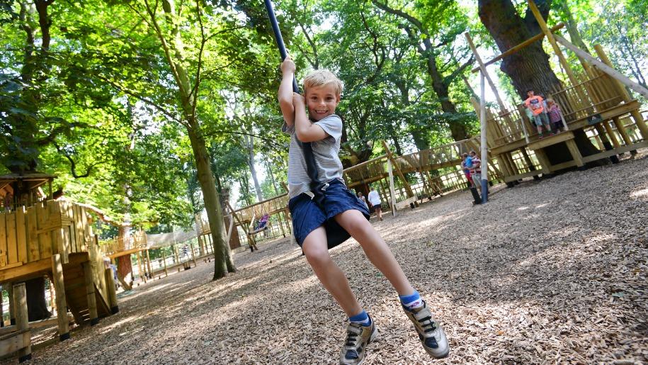 Child on rope swing