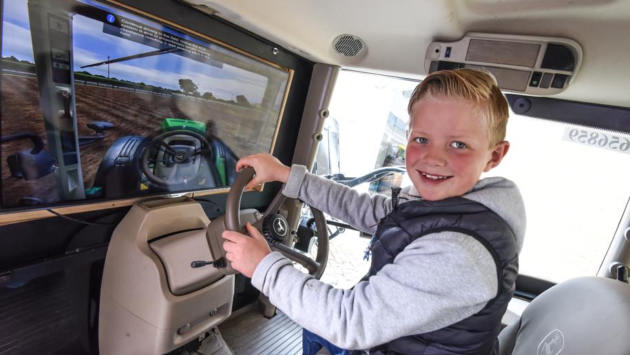 boy on driving simulator
