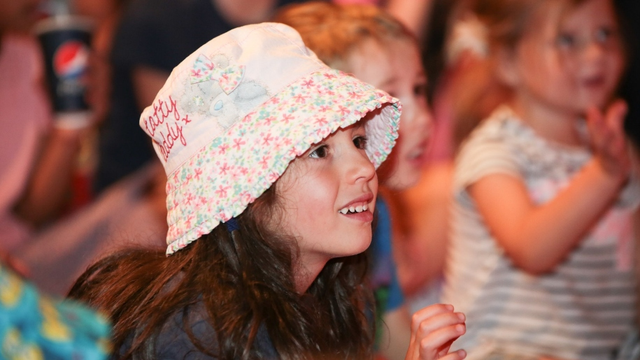 girl with hat on in audience
