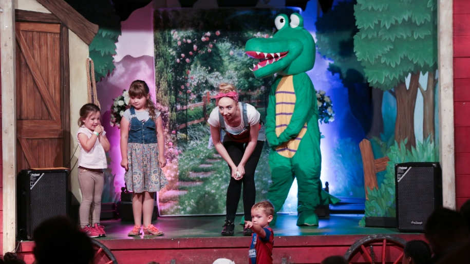 actors and kids on stage