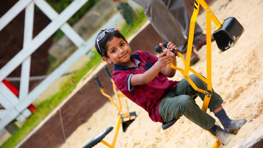 boy on playground apparatus