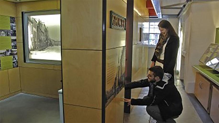 man and woman using interactive display