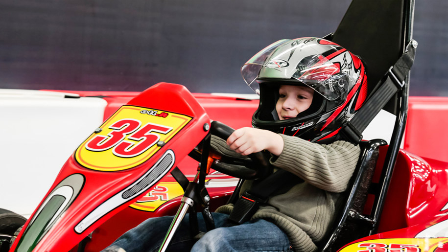 little boy in go kart