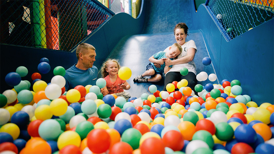 mother and children in ball pool