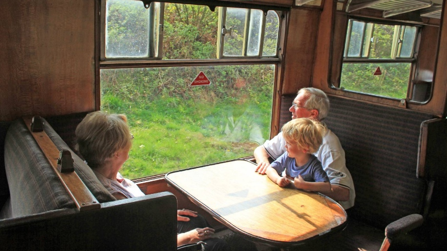 grandparents and child on train