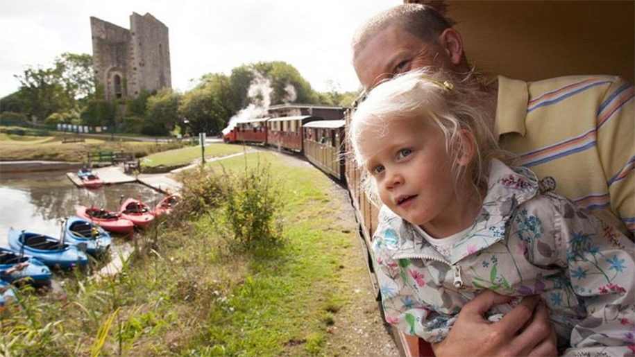little girl and mother on steam train