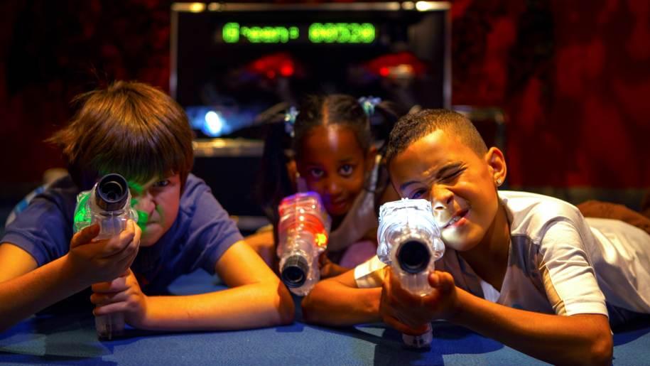 kidspace kids playing laser tag with guns