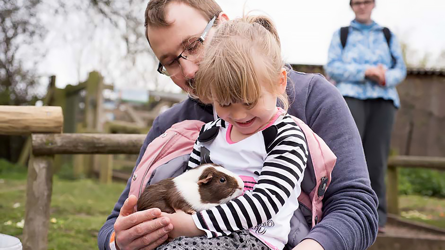 girl and father with guinea pig