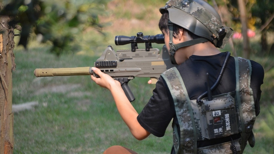 boy pointing laser gun