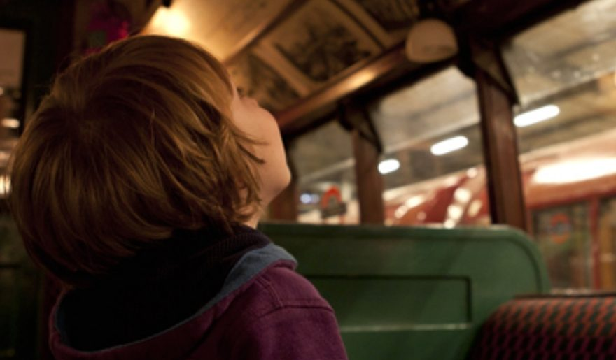 child looking at roof of bus