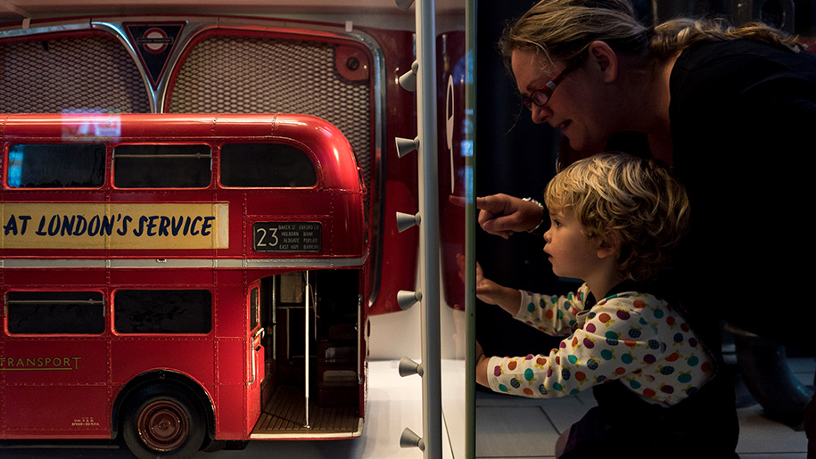 child looking at bus