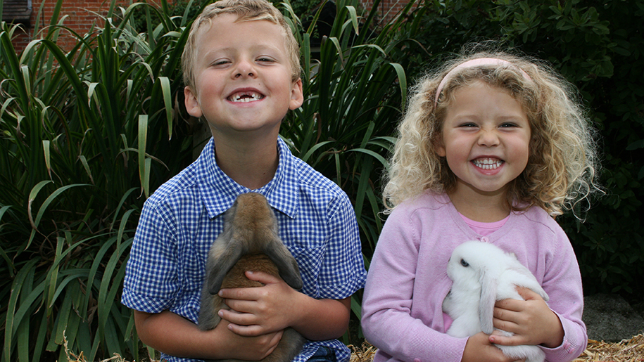 Longdown Activity Farm kids with rabbits