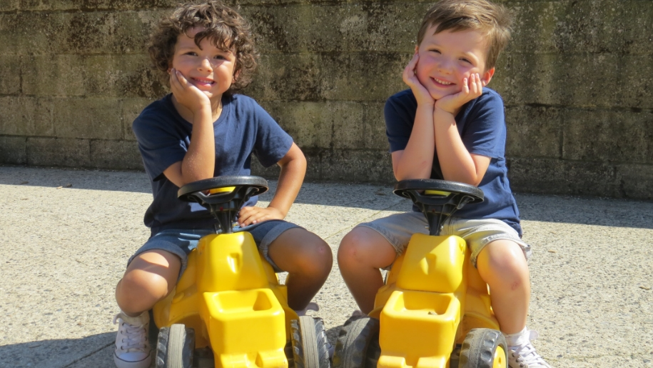 Two boys on mini tractors