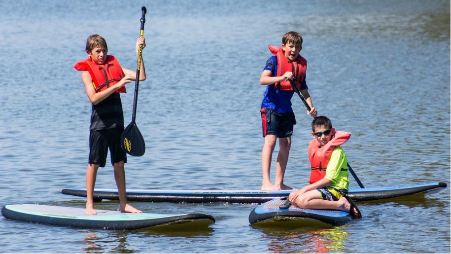boys paddle boarding