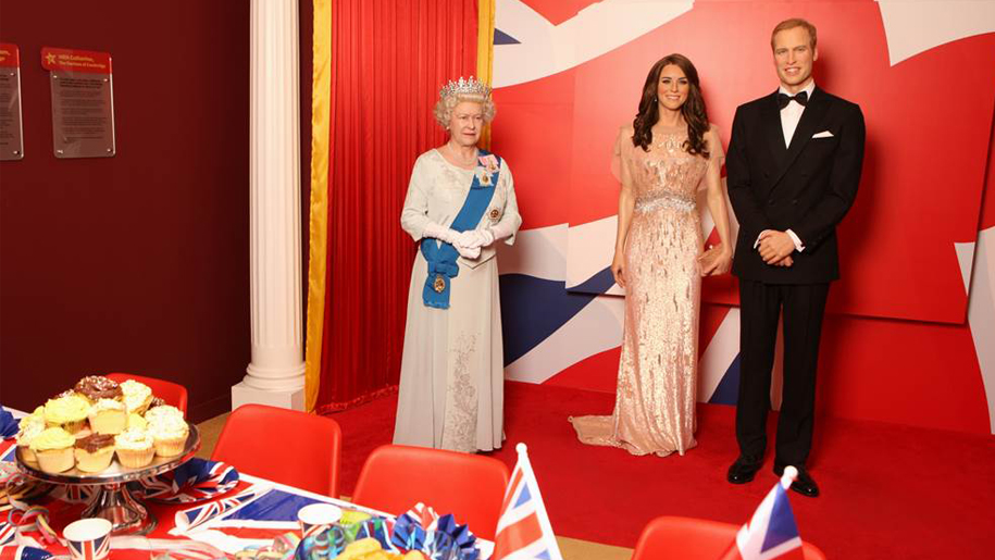 wax figures of the queen, prince william and kate