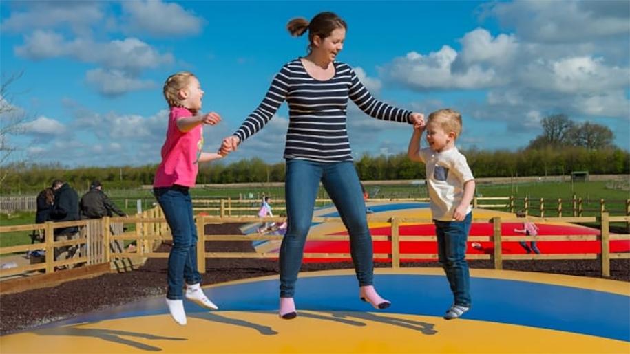 Kids and mum jumping